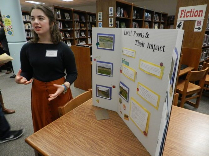 Sherando High School senior Ariana Piacquadio presents her project on farm-to-table efforts after a mentorship with One Block West chef Ed Matthews at the Gifted Independent Study showcase. Rachel Mahoney